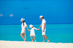 Young parent and little kid on white tropical Stock Images
