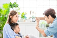 Young parent play with child. Happiness asian family - Young parent play with child happily at home royalty free stock images