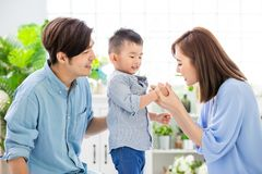 Young parent play with child. Happiness asian family - Young parent play with child happily at home stock photos
