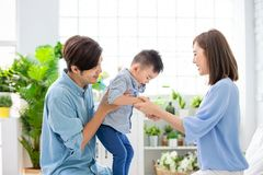Young parent play with child. Happiness asian family - Young parent play with child happily at home stock images