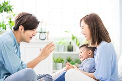 Young parent play with child. Happiness asian family - Young parent play with child happily at home stock photo