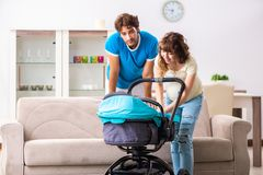 The young parents with baby expecting new arrival. Young parents with baby expecting new arrival stock images