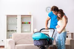 The young parents with baby expecting new arrival. Young parents with baby expecting new arrival royalty free stock image