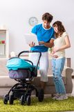 The young parents with baby expecting new arrival. Young parents with baby expecting new arrival stock image