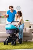 The young parents with baby expecting new arrival. Young parents with baby expecting new arrival stock photography