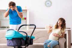 The young parents with baby expecting new arrival. Young parents with baby expecting new arrival royalty free stock photos