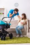 The young parents with baby expecting new arrival. Young parents with baby expecting new arrival stock photo