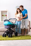 The young parents with baby expecting new arrival. Young parents with baby expecting new arrival royalty free stock photo