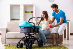 The young parents with baby expecting new arrival. Young parents with baby expecting new arrival royalty free stock images
