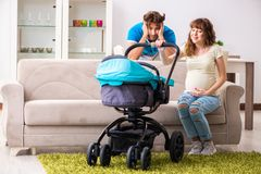 The young parents with baby expecting new arrival. Young parents with baby expecting new arrival stock photos