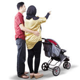 Young parents with a baby stroller Stock Photos