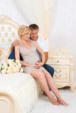 Young parents in bed expecting a little baby, Romantic moments for pregnant couple.  Stock Images