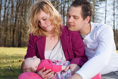 Young parents caring of their little baby girl Royalty Free Stock Image