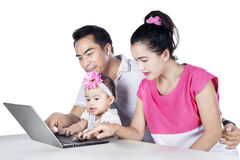Young parents and child looking at laptop Royalty Free Stock Photo