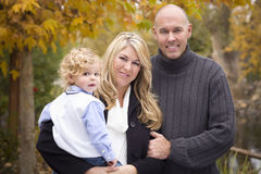 Young Parents and Child Portrait in Park Stock Image