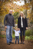 Young Parents and Child Portrait in Park Stock Photos