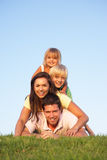Young parents, with children, posing on a field Stock Images