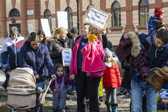 Young parents with children protest as Romania relaxes corruption law Stock Images