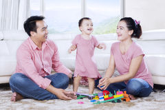 Young parents and daughter playing together Royalty Free Stock Image