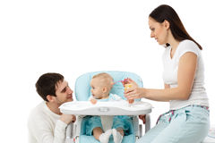 Young parents feed  baby. Stock Photos