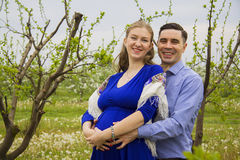 Young parents in garden Stock Photo