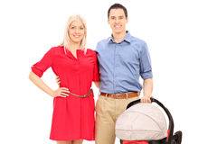Young parents holding a baby stroller Stock Photography