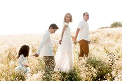 Free Young Parents Holding The Hands Of Two Children Stock Images - 140137054