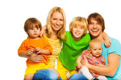 Young parents with kids Stock Images