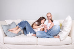Young parents with little baby at home Royalty Free Stock Images