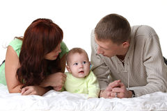 Young parents are looking at a little baby Royalty Free Stock Images
