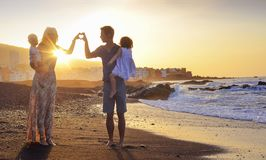 Young parents making a heart sign Stock Image