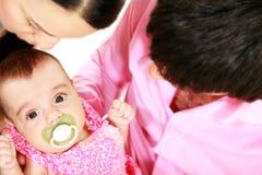 Young parents with newborn daughter Stock Photos