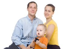 Young parents sit near the child Stock Images