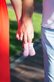 Young parents with socks for the newborn baby. Royalty Free Stock Photos