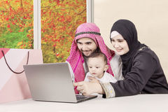 Young parents and son looking at laptop Stock Photography