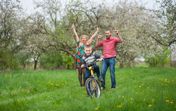 Young parents teaching his son to ride a bike Royalty Free Stock Image
