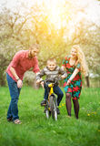 Young parents teaching his son to ride a bike Royalty Free Stock Images