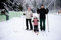 Young parents and their daughter do Nordic skiing Royalty Free Stock Photo