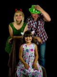 Young parents with their girl ,  studio shot Royalty Free Stock Photos