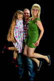 Young parents with their girl ,  studio shot Stock Image