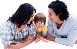 Young parents with their son lying on the floor Stock Photos