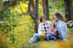 Young parents and their toddler girl having fun royalty free stock photography