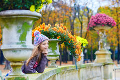 Young Parisian girl in the Luxembourg garden. On a bright fall day stock photography