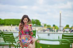 Young Parisian woman eating ice cream Royalty Free Stock Photo