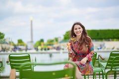 Young Parisian woman eating ice cream Royalty Free Stock Photos