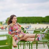 Young Parisian woman eating ice cream Royalty Free Stock Photography