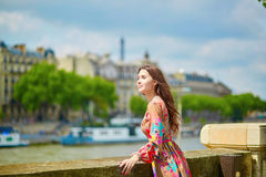 Young Parisian woman on the Seine embankment Royalty Free Stock Photo