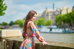 Young Parisian woman on the Seine embankment Royalty Free Stock Photography