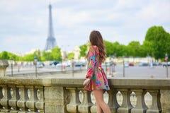 Young Parisian woman in the Tuileries garden Royalty Free Stock Photos