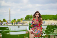 Young Parisian woman in the Tuileries garden Stock Image